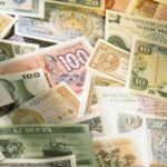 The symbolism of five cash notes around the globe